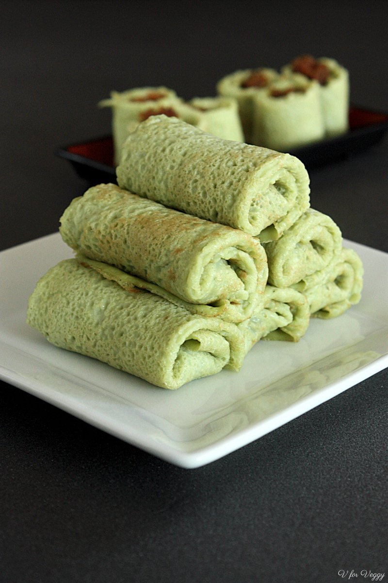 Indonesian dadar gulung (pandan crepes with coconut filling).